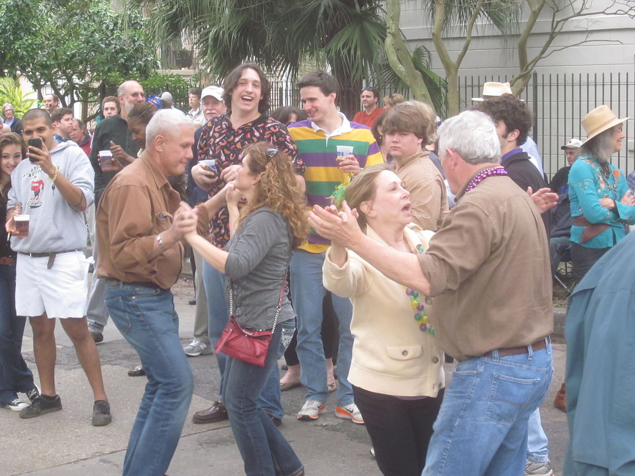 Small business owners dancing in the street.